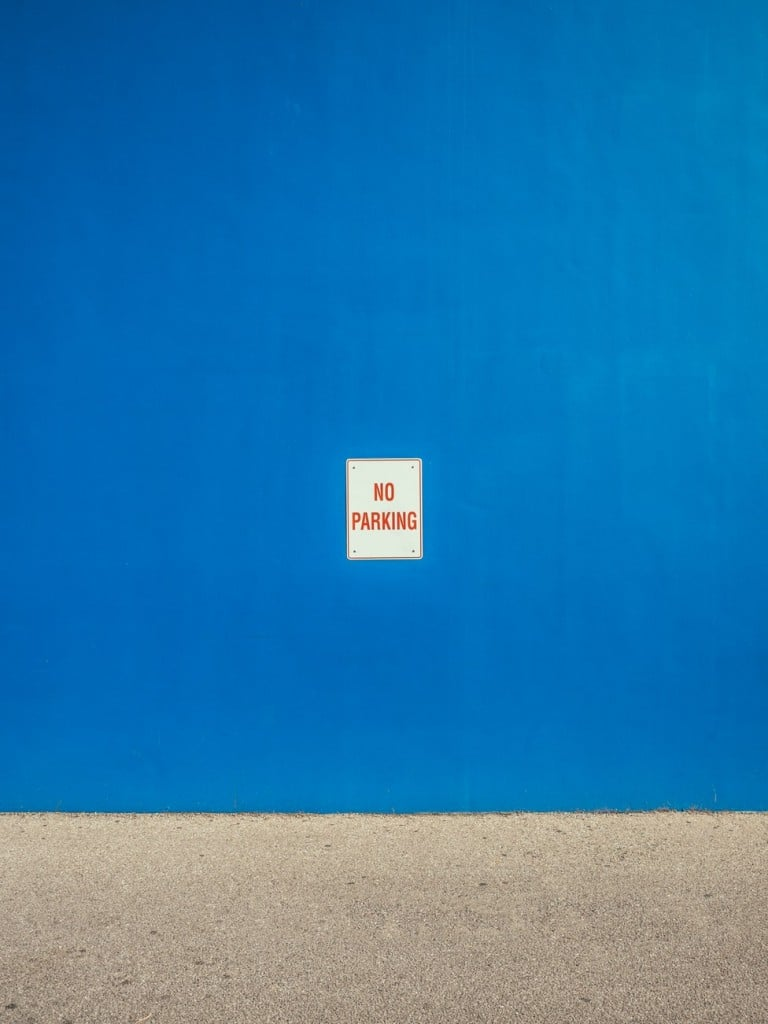 Blue wall with simple rules on it no parking Generative Change Life Changing Coaching Online By Phone