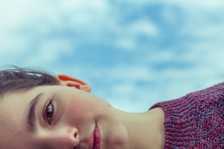 Woman lying on side in red jumper mind reading change