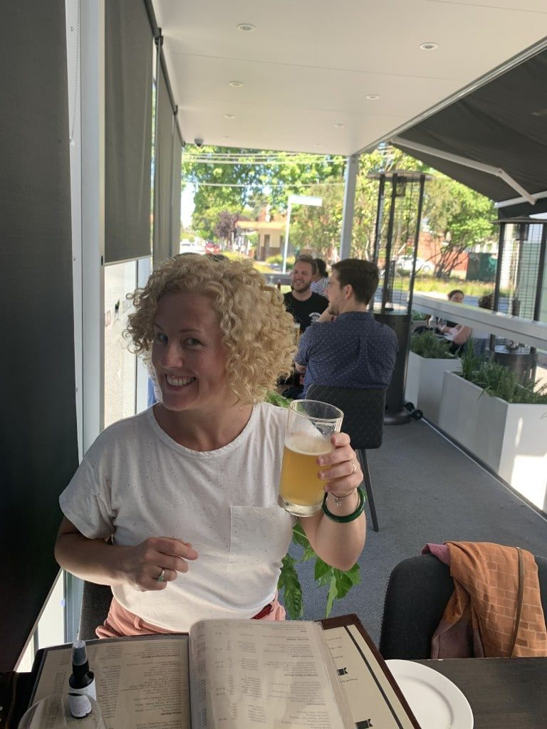 Rachel Carroll Generative Change Life Changing Coaching Online By Phone drinking a beer