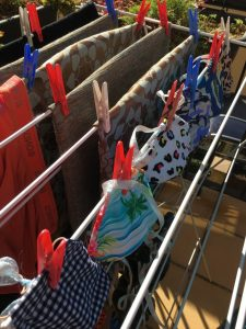 Reusable cloth masks on clothesline living in Melbourne right now Generative Change