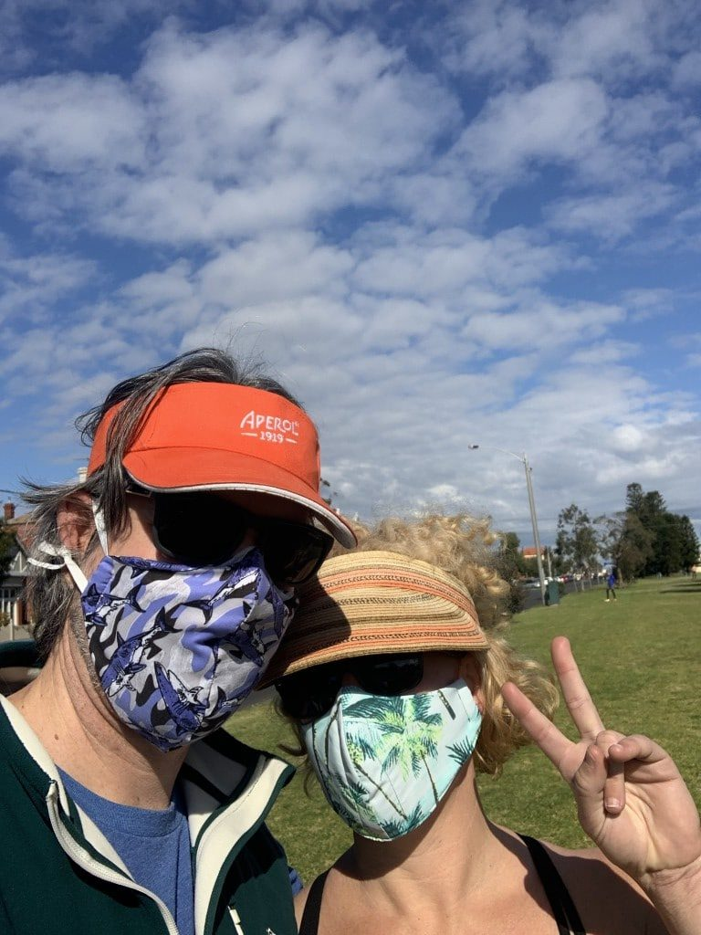 Two people with masks on living in Melbourne right now Generative Change