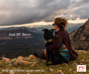 dog sitting with woman on mountaintop grief