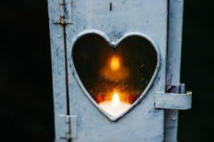 Candle burning in heart grief love