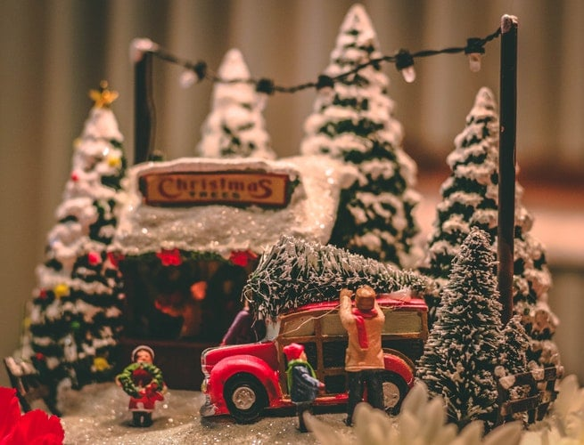Generative change life changing coaching tools for inspiration and change toy family loading Christmas tree on car