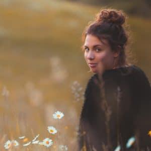 woman looking back in field grief