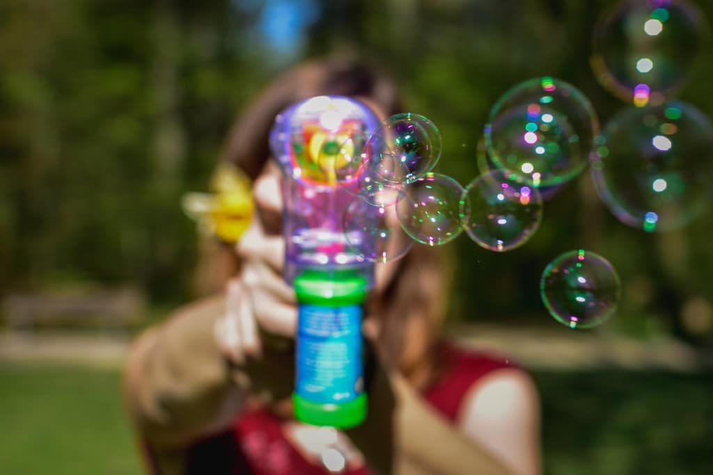 woman with coloured bubble gun shooting the messenger Generative Change Life Changing Coaching Online and by Phone
