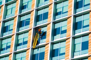 man absailing cleaning windows is your help helping Generative Change Life Changing Coaching Online & by Phone